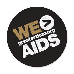 """WE > AIDS"" round label designed in the black/gold theme to promote GTA  (1000/roll)"